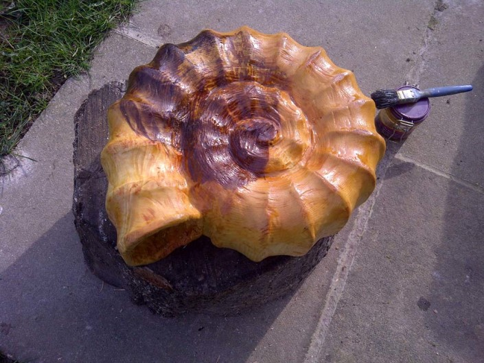 Chainsaw Sculpture Galleries | Ammonite Carving finsihed in oil