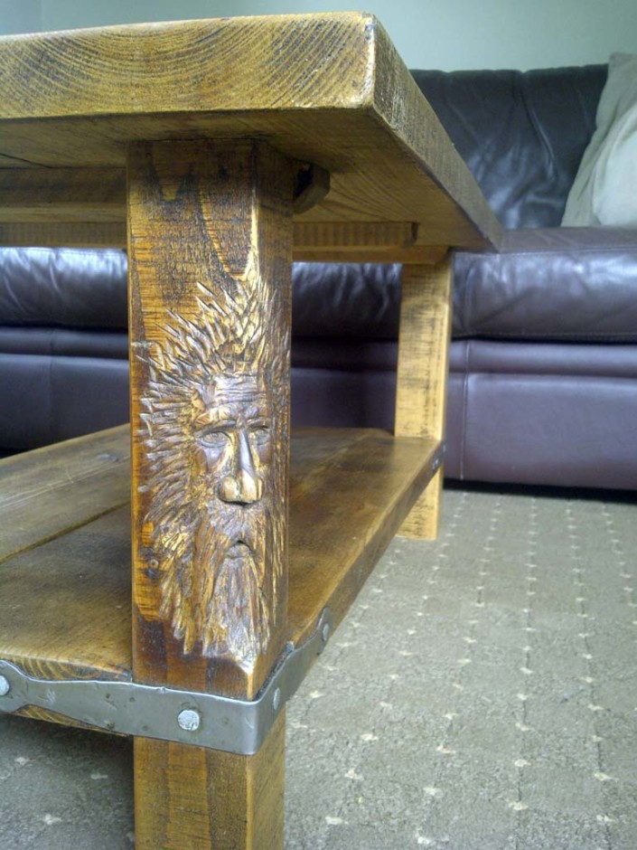 Chainsaw Sculpture Gallery | a Wood Spirit carved by chainsaw in a solid wood coffee table